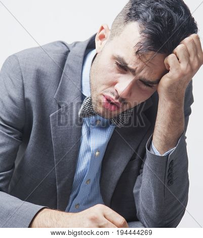 I no longer have the strength. I hate my office work. Young businessman working in the office. (Low wages overtime working hours lack of career prospects unfreedom)