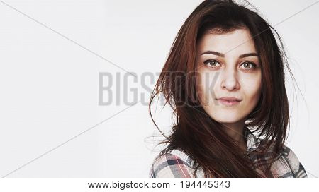 Femininity. Beauty portrait of a young beautiful brunette girl with long straight hair.