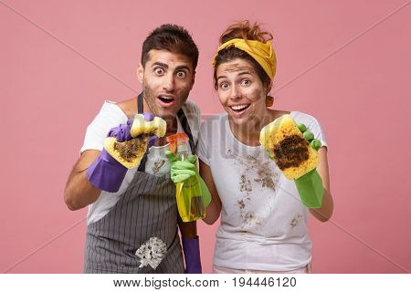 Workers From Service Cleaning Wiping Out Dust With Sponges Very Thoroughly Posing Against Pink Backg