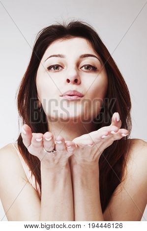 young beautiful woman sending air kiss (body language gestures psychology)