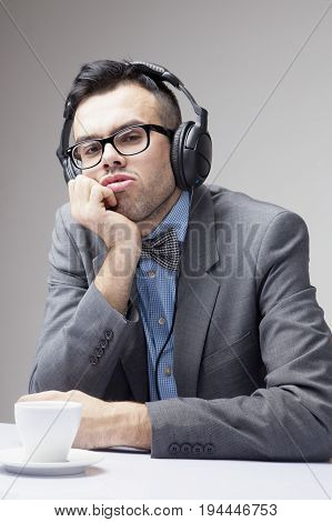 Coffee Break. Sucessful businessman enjoying in a cup of coffee and music