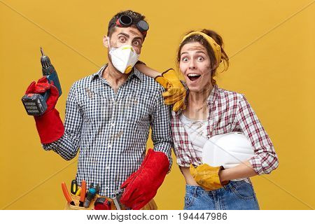 Maintenance Workers Wearing Casual Clothes Holding Builduing Equipment Having Surprised Look Not Bel