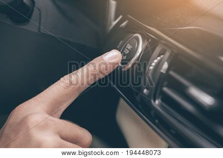 Young business person test drive new vehicle push button