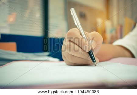 hands writing application form with pen business on folder files in office desk