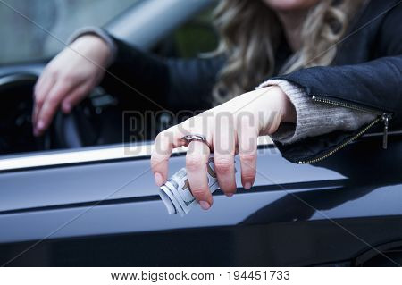 The woman driver of the car offering cash money. (corruption fraud money finance concept)