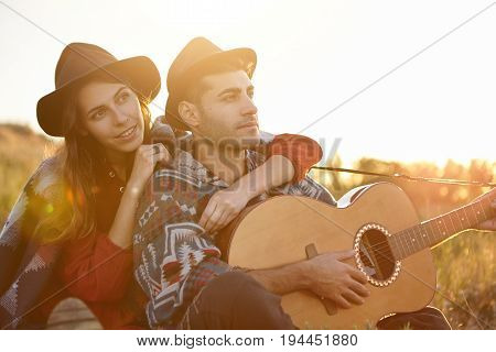 People, Relationships And Love Concept. Pretty Woman Wearing Black Summer Hat Embracing His Boyfrien
