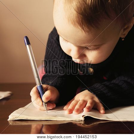 Office work. Little business baby girl works with documents. (Humorous Photo)