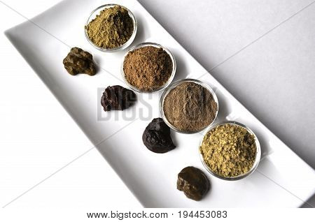 A selection of various natural henna (Lawsonia inermis) hair color dyes wet mixture isolated on white