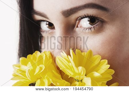Close-up portrait of Beautiful young girl smell a flower. (Pleasure nature travel vacation)