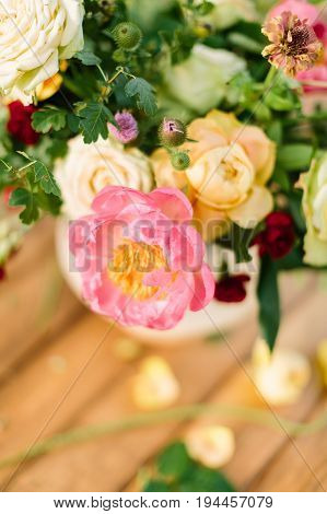 wedding, celebration, nature, gardening concept - close-up of chic bouquet composed of delicate avalanches, roses, dianthuses and tender peony, and decorated with leaves of oak and raspberry-bush