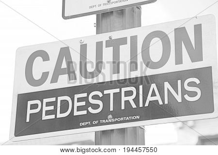 Caution pedestrians crossing sign traffic sign on street