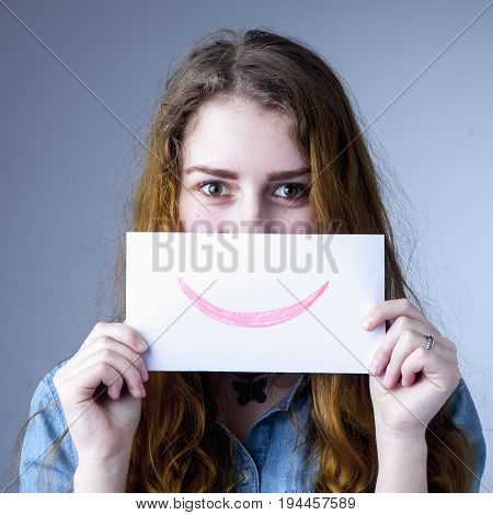 Young woman with Smiley Emoticons (mask role. deception theater)