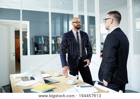 Businessman explaining terms of working to new employee