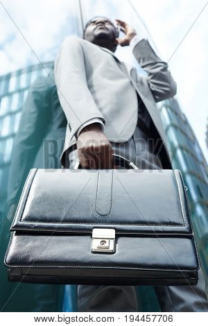 Leather briefcase in hand of modern salesman