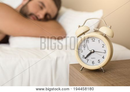 Young male traveler tourist hotel accomodation alarm clock
