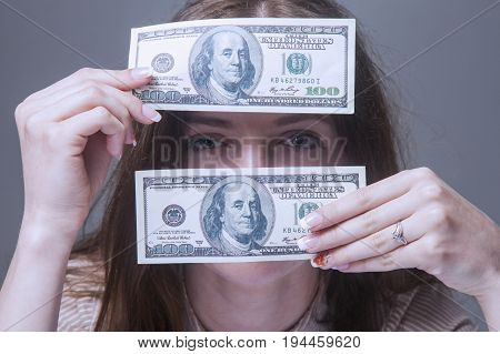 world through money (young girl with dollars)