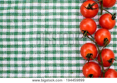 Red Cherry Tomatoes Lie On A Colored Towel, Place For Text, Background