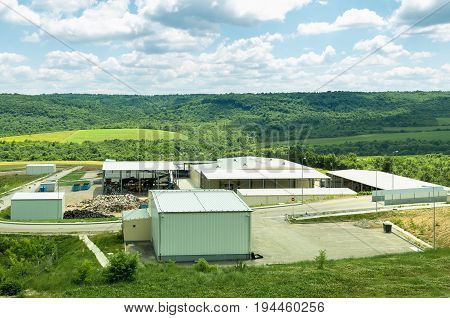 Urban landfill. Waste treatment plant depot, preparing it for separation. Waste disposal, management, reuse, recycle and recovery concept.