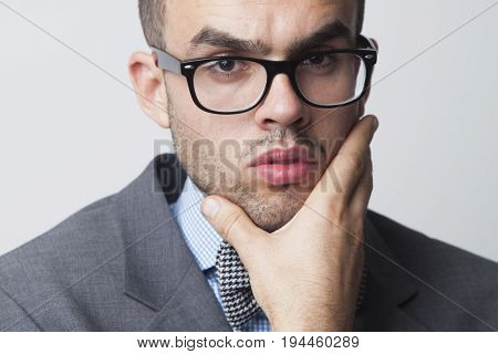 Young businessman thinking and looking for ways to overcome difficulties (Body language gestures facial expressions psychology concept)