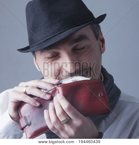 I love a smell of money. Satisfied man with smiling face holding US. (Wealth business success profit concept)