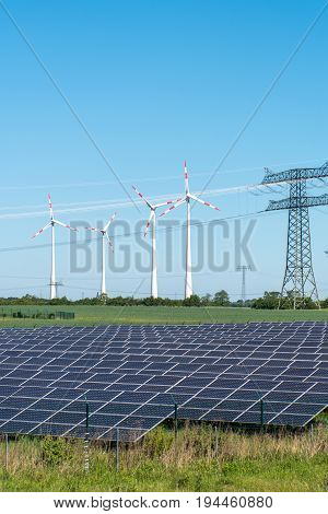 Photovoltaic and wind power with overhead wires seen in Germany