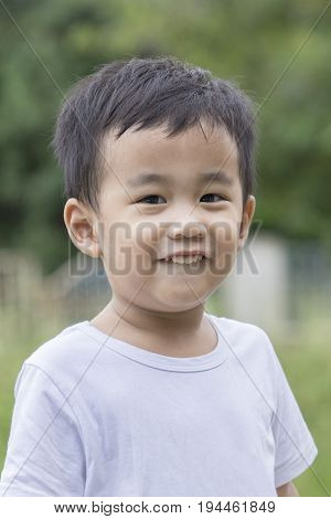 poratriat head shot of toothy smiling face of asian 1 year old children