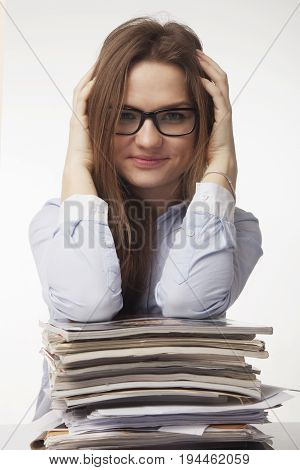 Happy young businesswoman working with documents. High salaries career development prospects. (Body language gestures psychology)