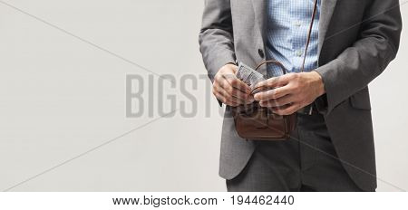 Businessman count pack of one hundred dollars in office (Freedom success money)