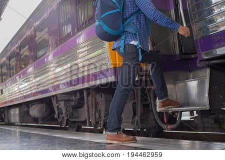 man traveler with backpacker at trainstation travel concept