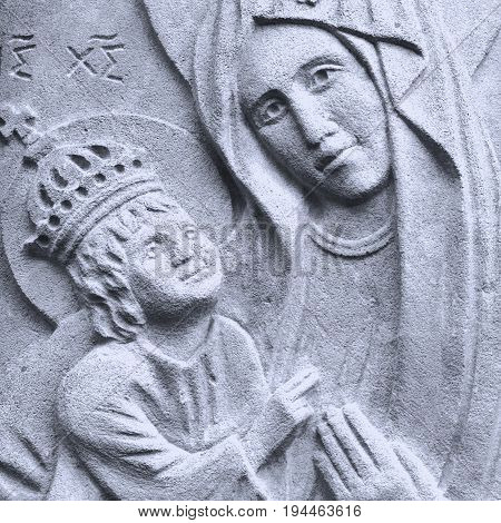statue of the Virgin Mary with the baby Jesus Christ in her arms