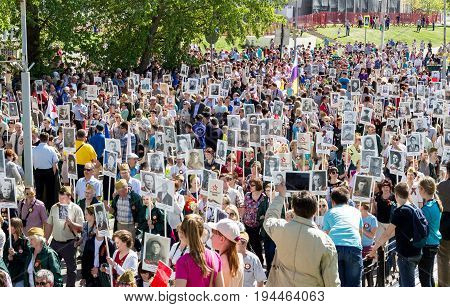 Udomlya City, Russia - 9 May 2016: Victory Day: Parade of an immortal regiment in the city of Udomlya. People with portraits of those killed in the Second World War.