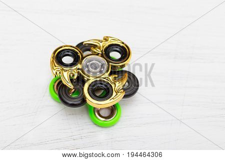 Group of fidget spinner stress relieving toy on white wooden background