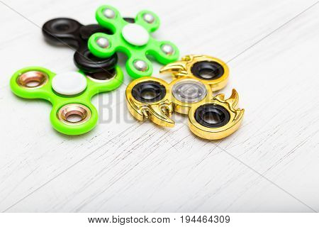 Hand spinners or fidgeting spinners. Many types and shapes of spinners