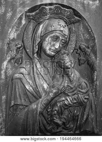 antique statue of the Virgin Mary with the baby Jesus Christ (Religion faith eternal life God the soul concept)