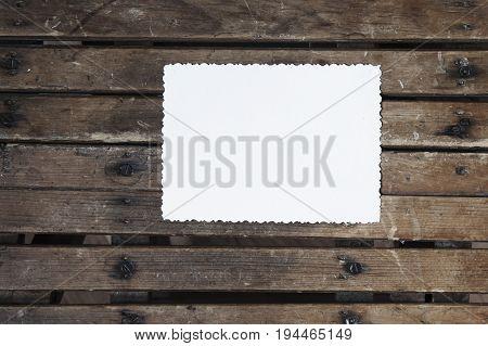 Blank vintage postcard and envelope on old wooden background
