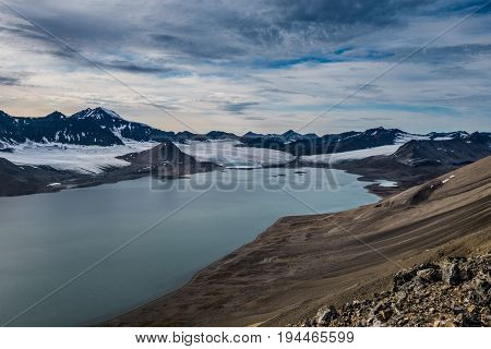 Glacier and mountain range under the clouds Svalbard