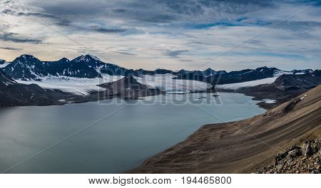 Glaciers and mountain range under the clouds Svalbard