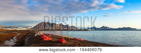 Campsite tents in Svalbard at midnight sun