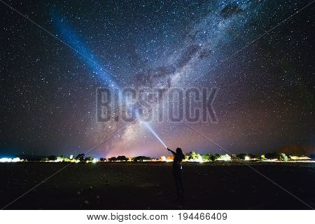 Girl With Flashlight Pointing To The Galaxy At The Sky.  Milky Way Over Sesriem Camping Site, Namibi