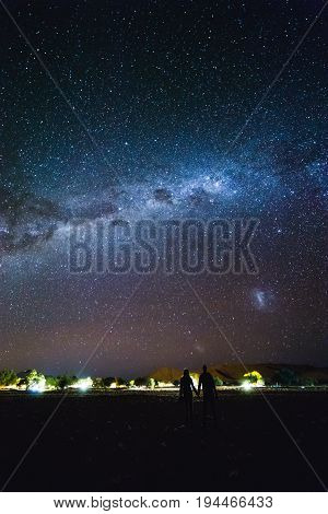 Coupleand The Galaxy At The Sky.  Milky Way Over Sesriem Camping Site, Namibia.