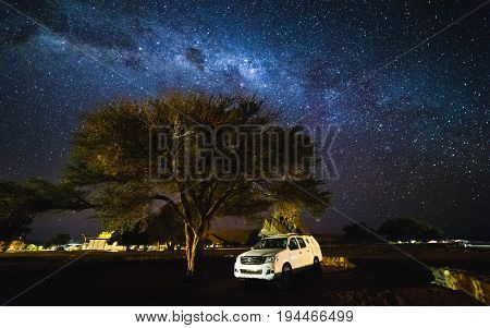 Sesriem, Namibia- 20 May 2017:  Toyota Hilux With Roof Top Tent And The Galaxy At The Sky.  Milky Wa