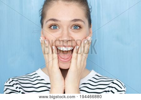 Close Up Portrait Of Female With Oh My God, Wow Emotion Expression. Pleasantly Surprised Smiling You