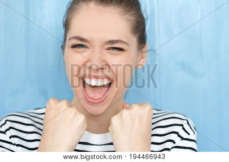 Close Up Portrait Of Excited Shouting Young Female Raising Her Fists With  Happiness, Having Great M