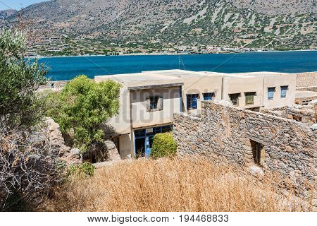 View From The Top Of Spinalonga Fortress Later A Leper Colony On The Small Building With Colorful Do