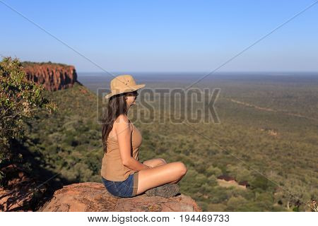 Girl Sitting On Stone On The Cliff At An Forest Landscape.