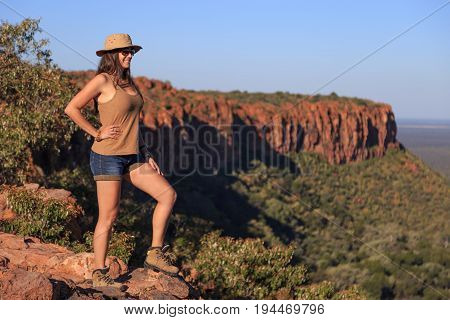 Girl Using Hat At An African Landscape. Waterberg Plateau, Namibia