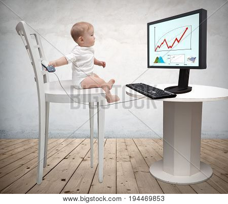Picture of a little baby playing with a computer