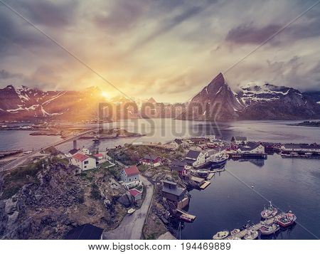 The Typical Norwegian fishing village on the Lofoten in northern Norway Under midnight sun, with the typical rorbu houses.  Aerial view
