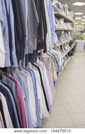 Men's shirts on the counter of the store