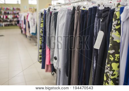 Men's sports pants on the counter of the store